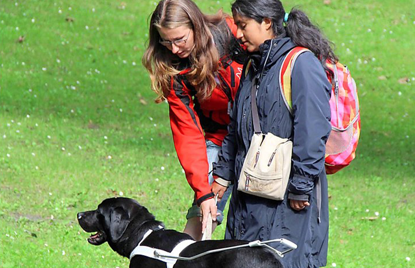 Aurélie and guide dog Nalu during the training in Bruges, BE.